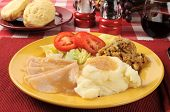 image of biscuits gravy  - Sliced turkey with mashed potatoes dressing salad and buttermilk biscuits - JPG