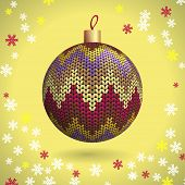 picture of knitting  - Multicolored Knitted Christmas Ball on the Yellow Background of Snowflakes Knitted - JPG