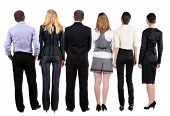 image of backside  - Back view of  business team looks at wall - JPG