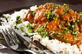 stock photo of garam masala  - Chicken tikka masala served with rice and garnished with cilantro leaves - JPG