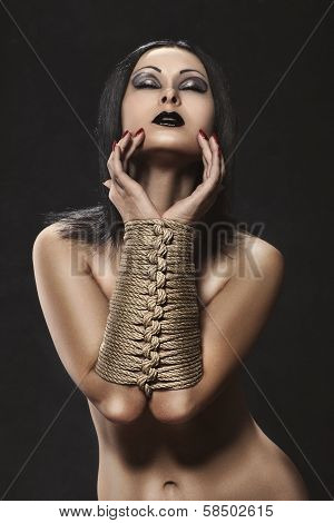 Girl With Hands Tied In Bondage.