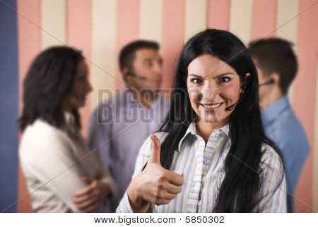 Happy Call Center Woman Giving Thumbs Up