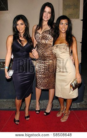 HOLLYWOOD - July 07: Kim Kardashian with guest and Kourtney Kardashian at A Midsummer Night's Dream: A Magic Night of Poker, Players and Stars in The Avalon on July 07, 2006 in Hollywood, CA.