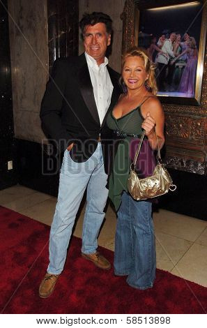 HOLLYWOOD - AUGUST 15: Charlene Tilton and friend at the Los Angeles Premiere of