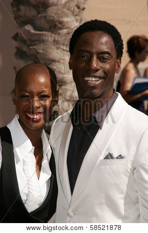 LOS ANGELES - AUGUST 19: Isaiah Washington and wife Jenisa at the 58th Annual Creative Arts Emmy Awards on August 19, 2006 at Shrine Auditorium in Los Angeles, CA.