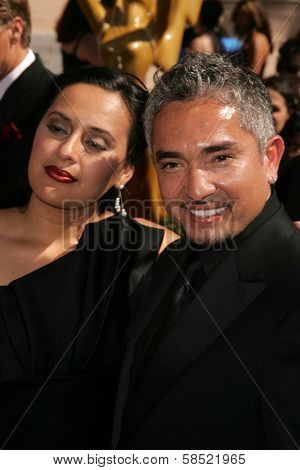LOS ANGELES - AUGUST 19: Cesar Millan and friend at the 58th Annual Creative Arts Emmy Awards on August 19, 2006 at Shrine Auditorium in Los Angeles, CA.
