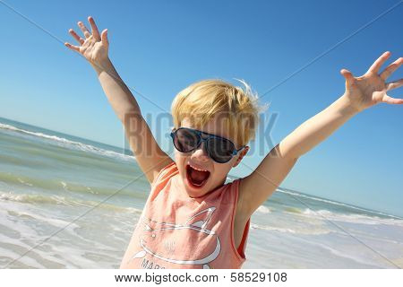 Super Happy Boy On Beach By Ocean
