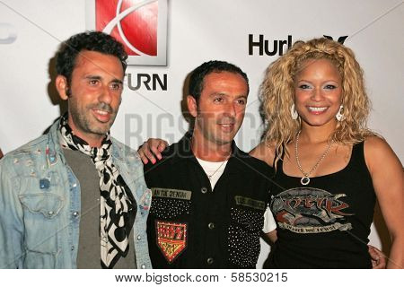 HOLLYWOOD - AUGUST 02: Alexander Caucant, Jules Naouri with Blu Cantrell wearing Clothing by Antik Denim at Saturn's X-Games 12 Party at 6820 Hollywood Blvd on August 02, 2006 in Hollywood, CA.