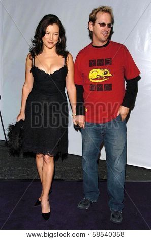 LOS ANGELES - APRIL 12: Jennifer Tilly and Phil Laak at the 3rd Annual Bodog Celebrity Poker Invitational at Barker Hangar on April 12, 2006 in Santa Monica, CA.