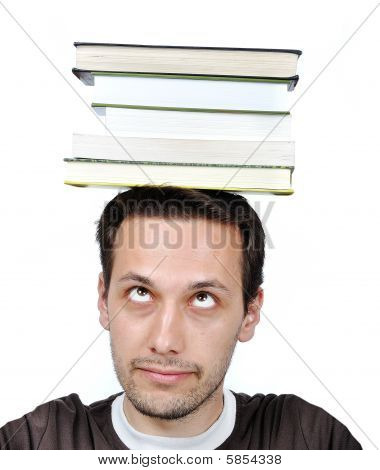 Young Male Holding Books With Expression On His Face