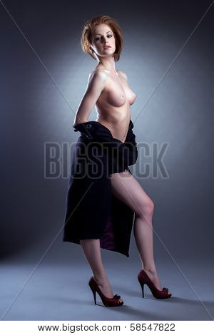 Image of sexual naked woman posing with coat
