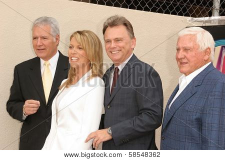HOLLYWOOD - APRIL 20: Alex Trebek and Vanna White with Merv Griffin and Pat Sajak at the Ceremony honoring Vanna White with a star on the Hollywood Walk of Fame on April 20, 2006 in Hollywood, CA.