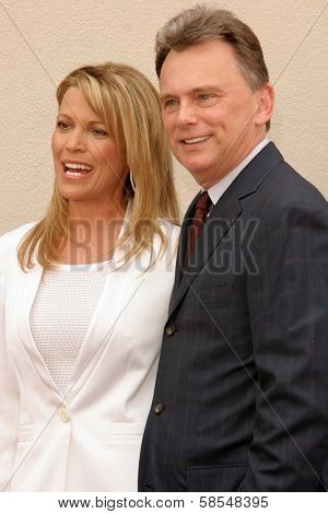 HOLLYWOOD - APRIL 20: Pat Sajak and Vanna White at the Ceremony honoring Vanna White with a star on the Hollywood Walk of Fame at Hollywood Boulevard on April 20, 2006 in Hollywood, CA.