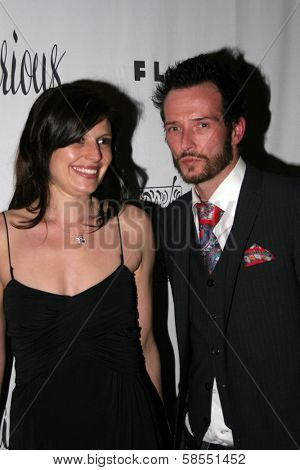 HOLLYWOOD - APRIL 06: Scott Weiland and his wife Mary at Flaunt Magazine Presents Nefarious Fine Jewelry Hosted by Velvet Revolver at Black Steel Restaurant on April 06, 2006 in Hollywood, CA.