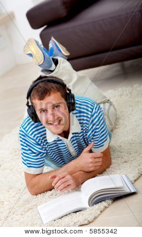 Man Studying And Listening To Music