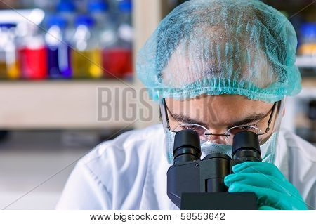 Male Chemist Working In A Laboratory.