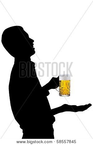 A Man Drinking A Glass Of Beer