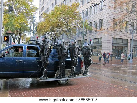Riot Police Riding on Truck