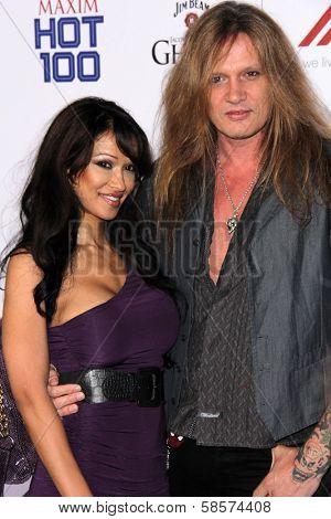 Sebastian Bach and guest at the 2013 Maxim Hot 100 Party, Vanguard, Hollywood, CA 05-15-13