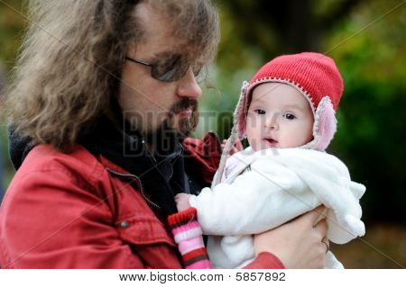 Young Father Holding Little Baby