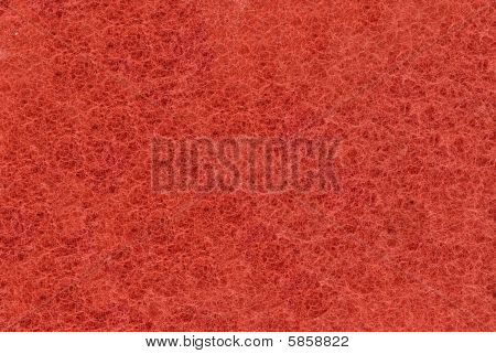 Close-up Of Red Synthetic Fibrous Surface