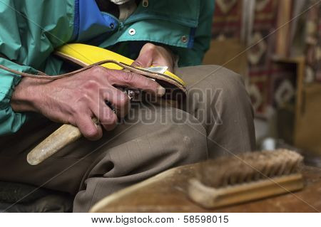Shoemaker at work in Morocco Africa