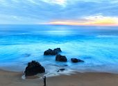 stock photo of pch  - Silhouette of Man Taking Photo of Garrapata State Beach at Sunset - JPG