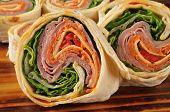 picture of sandwich wrap  - Closeup of a wrap sandwich with salami pepperoni and cheeses - JPG