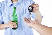 stock photo of sobriety  - Alcoholic giving a car key to someone for driving the car
