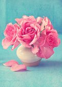 picture of bunch roses  - fresh pink roses in a ceramic vase on a blue background - JPG