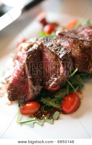 Grilled New York Strip On A Bed Of Arugula