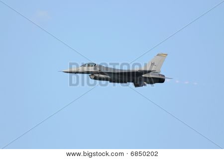 F-16 fighter plane in flight w/ afterburner