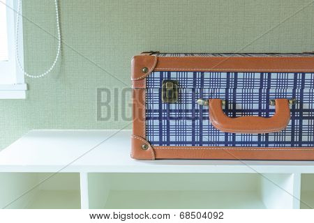 Baggage On White Wooden Shelf