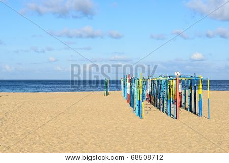 Tent Poles On The Beach, Nazare (portugal)