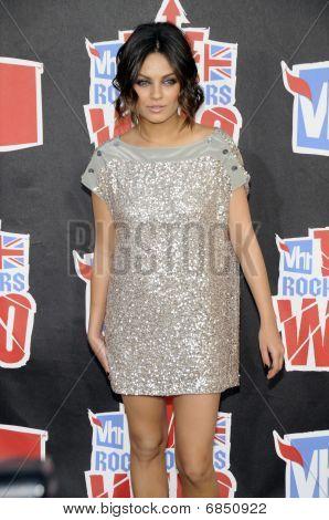 Mila Kunis appearing live.