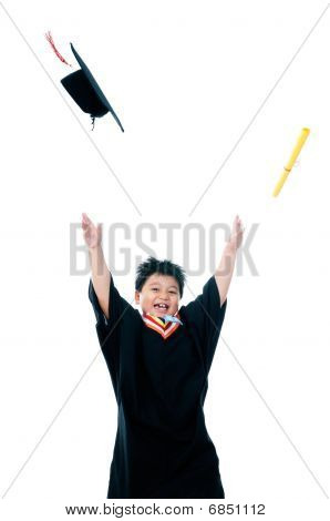 Happy Elementary Schoolboy With Hands Raised