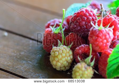 Closeup Of Raspberry On Wooden Table