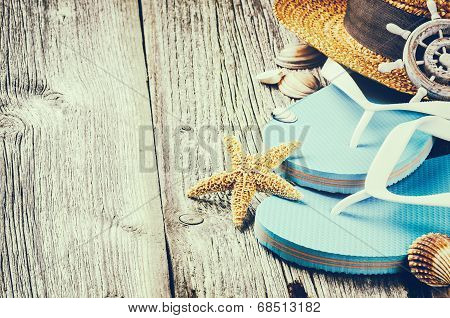 Summer Holiday Setting With Flip Flops And Straw Hat
