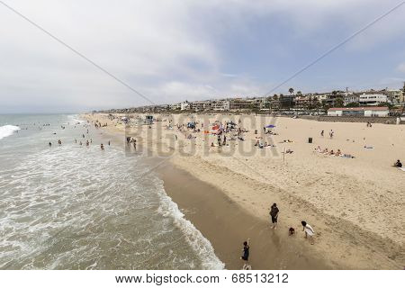 MANHATTAN BEACH, CALIFORNIA - July 15, 2014:  Summer beach goers and affluent homes in the town of Manhattan Beach in Los Angeles County.