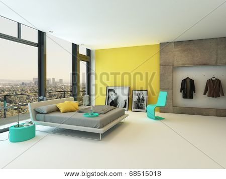 Spacious colorful bedroom interior with yellow wall accents, turquoise chair and cabinets and a double divan bed in grey in front of floor-to-ceiling windows with a view over the town