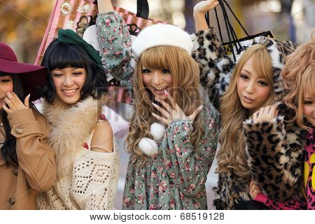 TOKYO,JAPAN, NOVEMBER 25, 2011: A group of girls is posing in the middle of the street for fashion advertising in the street near the Shibuya crossroad in Tokyo, Japan