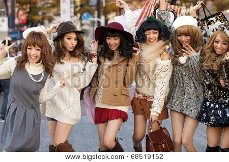 TOKYO,JAPAN, NOVEMBER 25, 2011 : A group of girls is posing in the middle of the street for fashion advertising in the street near the Shibuya crossroad in Tokyo, Japan.