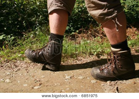 Legs with hiking boots of a wanderer