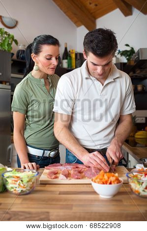 Young Happy Couple Preparing Lunch