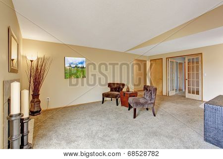 Empty Living Room In Soft Ivory With Fireplace