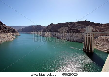 HOOVER DAM, NEVADA - SAT. JUNE 28, 2014: Dry, white cliffs show the severely reduced water level of Lake Meade at Hoover Dam, Nevada, on Saturday, June 28, 2014. Lake Meade is at record low levels.