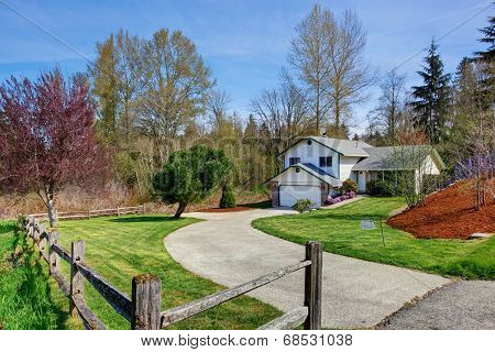 House Exterior. View Of Driveway And Front Yard