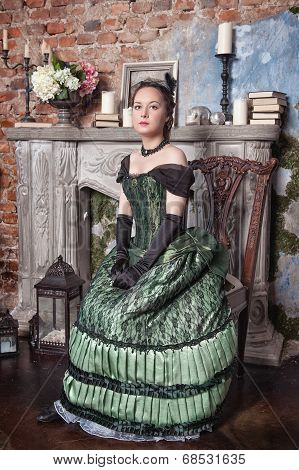 Beautiful Woman In Medieval Dress Near Fireplace