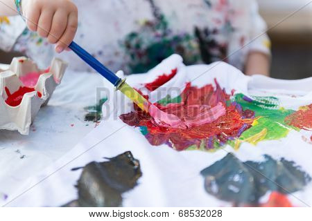 Child Painting On Cloth