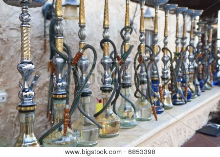 Arabic Shisha Waterpipes Lined Up In A Restaurant